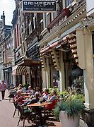 People sitting outdoors cafe tables Dordrecht, Netherlands
