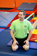 Jim Lark watches a gymnastics class at The Little Gym in Brentwood on Saturday, May 19, 2012.  (Photo by Kevin Bartram)