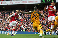 Nacho Montreal Of Arsenal (l) shoots and scores his sides first goal.<br /> Premier league match, Arsenal v Brighton & Hove Albion at the Emirates Stadium in London on Sunday 1st October 2017. pic by Kieran Clarke, Andrew Orchard sports photography.