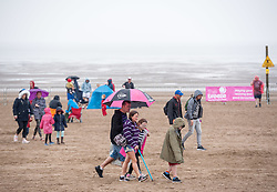 © Licensed to London News Pictures. 23/06/2019. Weston-super-Mare, North Somerset, UK. Crowds in the rain on Sunday after the Red Arrows display was aborted due to low cloud cover at the Weston Air Festival taking place over the weekend of 22 and 23 June in Weston Bay. Photo credit: Simon Chapman/LNP.