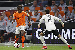 March 24, 2019 - Amsterdam, France - AMSTERDAM, Football, 24-03-2019, Euro qualification, Stadium Johan Cruyffarena. Netherlands player Quincy Promes and Germany player Thilo Kehrer during the game Netherlands - Germany. (Credit Image: © Panoramic via ZUMA Press)
