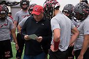 Head coach Mark Kirchhoff leads the Iraan High School football team through their final walkthrough to stretch their legs before getting on the busses for the last hour of their trip to Arlington for the state title game in Aledo, Texas on December 14, 2016. (Cooper Neill for The New York Times)