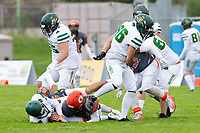 KELOWNA, BC - SEPTEMBER 22:  Kale Bergland #23 and Miguel Wood #47 of Okanagan Sun tackle a player of the Valley Huskers at the Apple Bowl on September 22, 2019 in Kelowna, Canada. (Photo by Marissa Baecker/Shoot the Breeze)