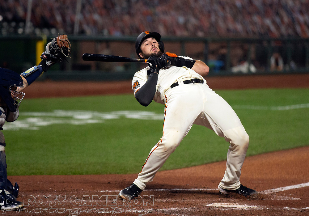 Sep 16, 2020; San Francisco, CA, USA; San Francisco Giants Joey Bart (21) ducks out the path of a high and tight pitch from Seattle Mariners starting pitcher Ljay Newsome during the third inning of a baseball game at Oracle Park. Mandatory Credit: D. Ross Cameron-USA TODAY Sports