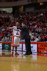24 February 2009: Emmanuel Holloway and Coach Tim Jankovich have a short tactical discussion during a free throw attempt by the Panthers. The Redbirds of Illinois State University lost the Panthers of Northern Iowa in double overtime by a score of 69-67 on Doug Collins Court inside Redbird Arena on the campus of Illinois State University in Normal Illinois