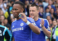 Football - 2014 / 2015 Premier League - Chelsea vs. Sunderland.   <br /> <br /> Chelsea's Didier Drogba with his GoPro camera prepares to collect his medal at Stamford Bridge. <br /> <br /> COLORSPORT/DANIEL BEARHAM
