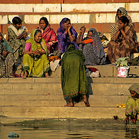 Asia, India, Varanasi. Women on the ghats of Varanasi on the Ganges River.