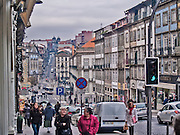 Oporto, December 2012. Street at downtown, UNESCO World Heritage Site. Buildings and people.