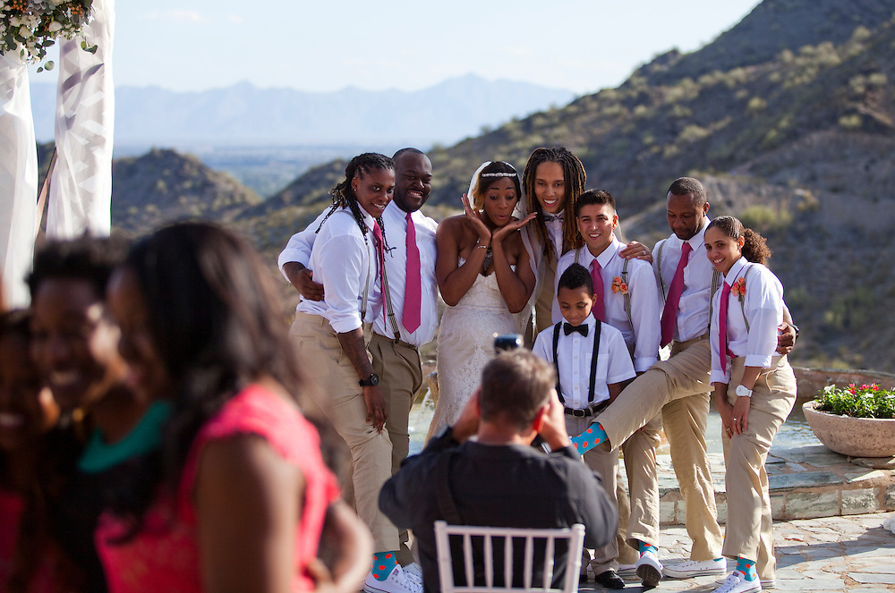 WNBA stars Glory Johnson and Brittney Griner pose for their wedding photographer with members of the wedding party during their wedding at the Pointe Hilton Tapatio Cliffs Resort in Phoenix, Ariz. on May 8, 2015.
