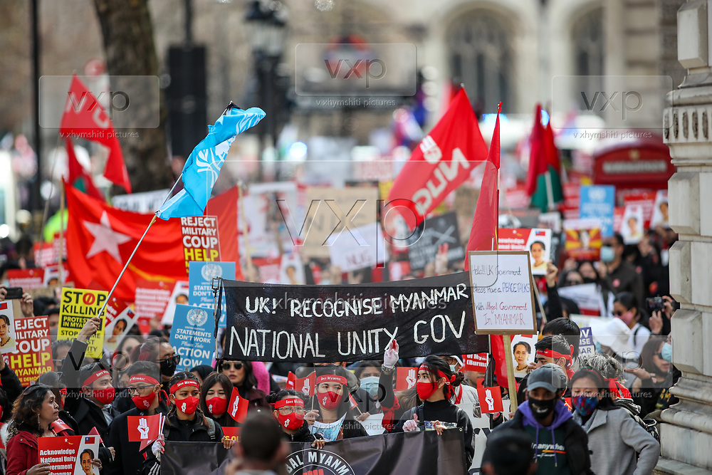 Men, women and children of the Burmese community in London chant and hold placards and banners against Myanmar's ruling junta as they march outside Downing Street in central London on Sunday, May 2, 2021. This is a series of protests following the locked out of the Myanmar envoy to the UK from the embassy three weeks ago on April 7. Myanmar's ambassador to the UK, Kyaw Zwar Minn, said the embassy has been seized by the military attache. (Photo/ Vudi Xhymshiti)