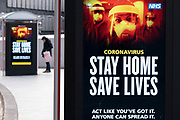 HM Government, and NHS advice boards that the new variant is spreading fast and to stay at home and save lives during the third national coronavirus lockdown in Birmingham city centre, which is deserted apart from a few people on 12th January 2021 in Birmingham, United Kingdom. Following the recent surge in cases including the new variant of Covid-19, this nationwide lockdown, which is an effective Tier Five, came into operation yesterday, with all citizens to follow the message to stay at home, protect the NHS and save lives.