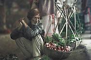 Man selling radishes, Hinimari market near Guwahati, Assam, India.