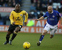 Photo: Pete Lorence.<br /> Leicester City v Barnsley. Coca Cola Championship. 16/12/2006.<br /> Kyle Reid charges down the wing, chased by Danny Tiatto.
