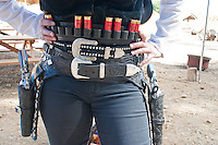 Cowgirl with Six Shooters and Belt loaded with Cartridges