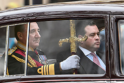 © Licensed to London News Pictures. 19/12/2019. London, UK. The Sword of State is seen being driven down The Mall on the way to The Houses of Parliament for the State Opening of Parliament. Photo credit: Ben Cawthra/LNP
