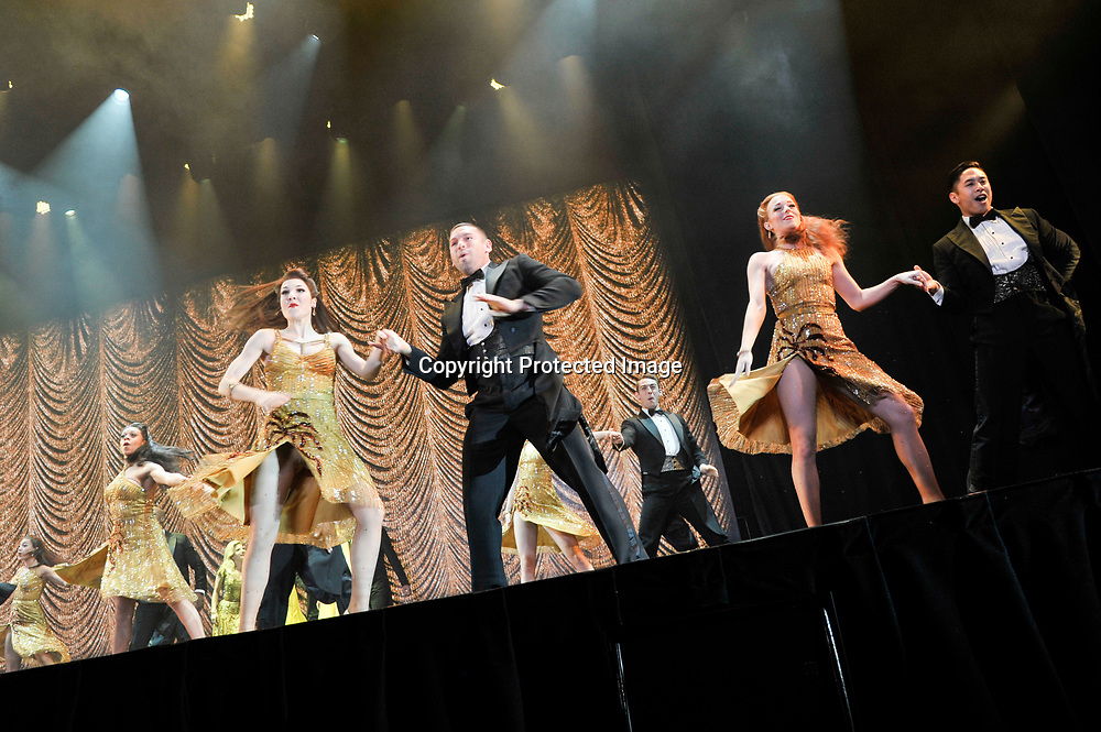 Members of the Broadway play Show Stoppers perform during the Chairman's Global Dinner at the Andrew W. Mellon Auditorium in Washington DC on January 17, 2017.