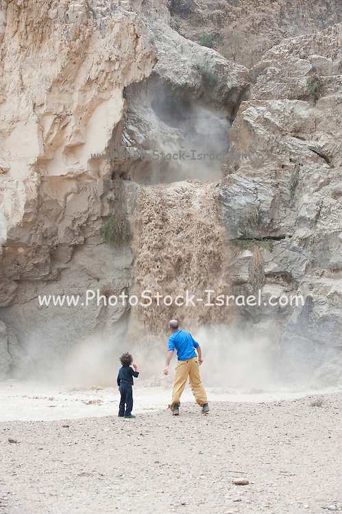 Israel, Dead Sea, A flash flood in the Kidron river washes away the road