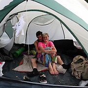 "Occupants of ""Camp Romney"" relax in their tent during the Republican National Convention in Tampa, Fla. on Wednesday, August 29, 2012. (AP Photo/Alex Menendez)"