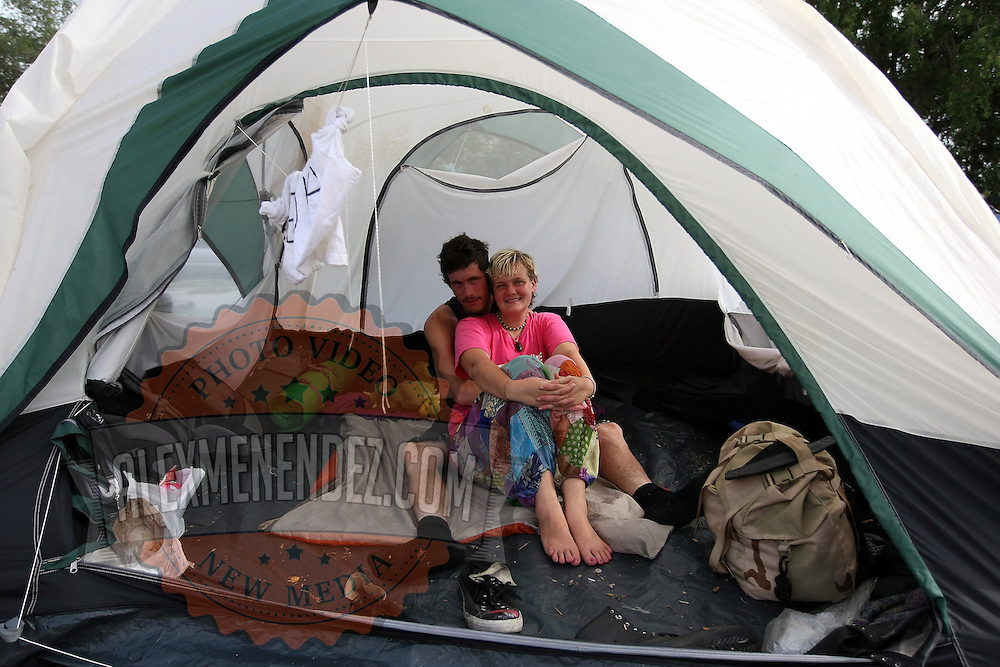 """Occupants of """"Camp Romney"""" relax in their tent during the Republican National Convention in Tampa, Fla. on Wednesday, August 29, 2012. (AP Photo/Alex Menendez)"""
