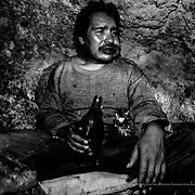 """A """"mandinga"""" resting after having completed his stint in the Siglo XX tin mine. Llallagua, Bolivia."""