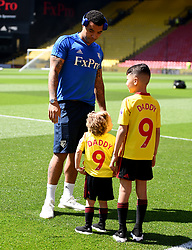 Watford's Troy Deeney plays with his children Amelia and Myles before the Premier League match at Vicarage Road, Watford.
