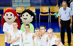 Players of Slovenia and Zmago Sagadin, head coach of Slovenia  listening to the national anthem during basketball match between National teams of Slovenia and Lithuania in First Round of U20 Men European Championship Slovenia 2012, on July 14, 2012 in Domzale, Slovenia.  (Photo by Vid Ponikvar / Sportida.com)