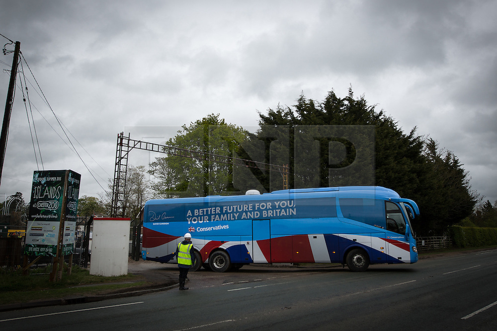 © Licensed to London News Pictures . 06/05/2015 . Chester , UK . The Conservative Party battle bus containing party leader David Cameron leaves a building site for an extension at Chester Zoo on the final day of the election campaign . Photo credit : Joel Goodman/LNP