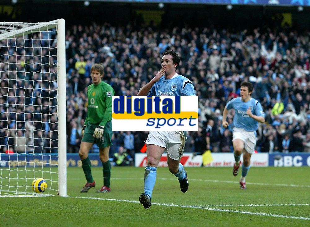 Photo: Andrew Unwin.<br /> <br /> Manchester City v Manchester United. The Barclays Premiership. 14/01/2006.<br /> <br /> Manchester City's Robbie Fowler (C) celebrates scoring his team's third goal.