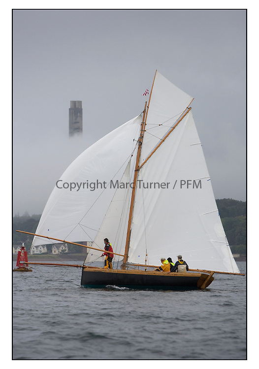 Ayrshire Lass 1887 Gaff Cutter with the misty Kip Tower...Sunday race from Largs to Rhu started damp but briefly lifted for a downwind race to the upper Clyde...* The Fife Yachts are one of the world's most prestigious group of Classic .yachts and this will be the third private regatta following the success of the 98, .and 03 events.  .A pilgrimage to their birthplace of these historic yachts, the 'Stradivarius' of .sail, from Scotland's pre-eminent yacht designer and builder, William Fife III, .on the Clyde 20th -27th June.   . ..More information is available on the website: www.fiferegatta.com . .Press office contact: 01475 689100         Lynda Melvin or Paul Jeffes