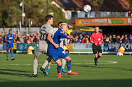 AFC Wimbledon striker Joe Pigott (39) getting fouled by Portsmouth defender Sean Raggett (20) during the EFL Sky Bet League 1 match between AFC Wimbledon and Portsmouth at the Cherry Red Records Stadium, Kingston, England on 19 October 2019.