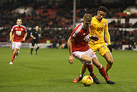 Nottingham Forest's Joe Worrall shields the ball from Preston North End's Callum Robinson<br /> <br /> Photographer Stephen White/CameraSport<br /> <br /> The EFL Sky Bet Championship - Nottingham Forest v Preston North End - Wednesday 14th December 2016 - The City Ground - Nottingham<br /> <br /> World Copyright © 2016 CameraSport. All rights reserved. 43 Linden Ave. Countesthorpe. Leicester. England. LE8 5PG - Tel: +44 (0) 116 277 4147 - admin@camerasport.com - www.camerasport.com