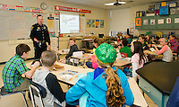 Officer Daniel O'Neil talks with Mr. Donovan's 5th grade students about the importance of the Basics of Communication during the D.A.R.E. ice cream party at Gilford Middle School on Thursday morning.  (Karen Bobotas/for the Laconia Daily Sun)