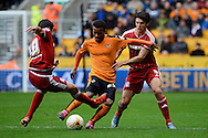 Middlesbrough midfielder Carlos De Pena challenges Wolverhampton Wanderers midfielder Nathan Byrne during the Sky Bet Championship match between Wolverhampton Wanderers and Middlesbrough at Molineux, Wolverhampton, England on 24 October 2015. Photo by Alan Franklin.