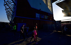 """Fans arrives at the stadium prior to the Premier League match at Turf Moor, Burnley. PRESS ASSOCIATION Photo. Picture date: Thursday April 19, 2018. See PA story SOCCER Burnley. Photo credit should read: Anthony Devlin/PA Wire. RESTRICTIONS: EDITORIAL USE ONLY No use with unauthorised audio, video, data, fixture lists, club/league logos or """"live"""" services. Online in-match use limited to 75 images, no video emulation. No use in betting, games or single club/league/player publications."""