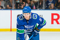 KELOWNA, BC - SEPTEMBER 29:  Troy Stecher #51 of the Vancouver Canucks lines up against the Arizona Coyotes at Prospera Place on September 29, 2018 in Kelowna, Canada. (Photo by Marissa Baecker/NHLI via Getty Images)  *** Local Caption *** Troy Stecher