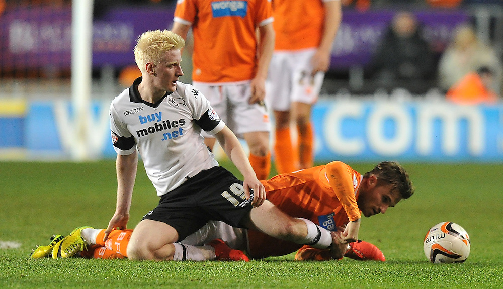 Blackpool's David Goodwillie battles with Derby County's Will Hughes<br /> <br /> Photo by Dave Howarth/CameraSport<br /> <br /> Football - The Football League Sky Bet Championship - Blackpool v Derby County - Tuesday 8th April 2014 - Bloomfield Road - Blackpool<br /> <br /> © CameraSport - 43 Linden Ave. Countesthorpe. Leicester. England. LE8 5PG - Tel: +44 (0) 116 277 4147 - admin@camerasport.com - www.camerasport.com