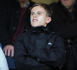 A young Bristol Rovers fan with face paint - Photo mandatory by-line: Dougie Allward/JMP - Mobile: 07966 386802 26/04/2014 - SPORT - FOOTBALL - High Wycombe - Adams Park - Wycombe Wanderers v Bristol Rovers - Sky Bet League Two