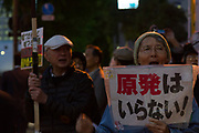 A small anti-nuclear and Anti-Prime Minister Shinzo Abe protest outside the national Diet building, in Nagatacho, Tokyo, Japan Friday April 20th 2018. Since the March 11th 2011 earthquake and tsunami in North East Japan there have been weekly, protests outside the government offices most Fridays calling for an end to nuclear power. Left wing activists also object to the hawkish policies of Prime Minister Abe and call for his resignation over corruption scandals and resistance to his desire to revise the pacifist constitution, allowing the Japanese military to once again take part in combat missions.