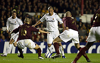 Photo: Chris Ratcliffe.<br /> Arsenal v Real Madrid. UEFA Champions League. 08/03/2006.<br /> Ronaldo cannot find a way past Matthieu Flamini (L) and Phillippe Senderos