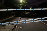 Police tape blocks local roads surrounding Herne Hill and Carnegie Library in Lambeth, after two people were reported shot in a nearby residential south London road, on 10th September 2020, in London, England. The two victims were taken to hospital with non-life threatening injuries.