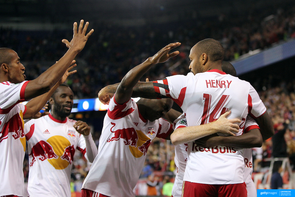Thierry Henry, New York Red Bulls, celebrates his match winning goal with team mates during the New York Red Bulls Vs Houston Dynamo, Major League Soccer regular season match at Red Bull Arena, Harrison, New Jersey. USA. 4th October 2014. Photo Tim Clayton