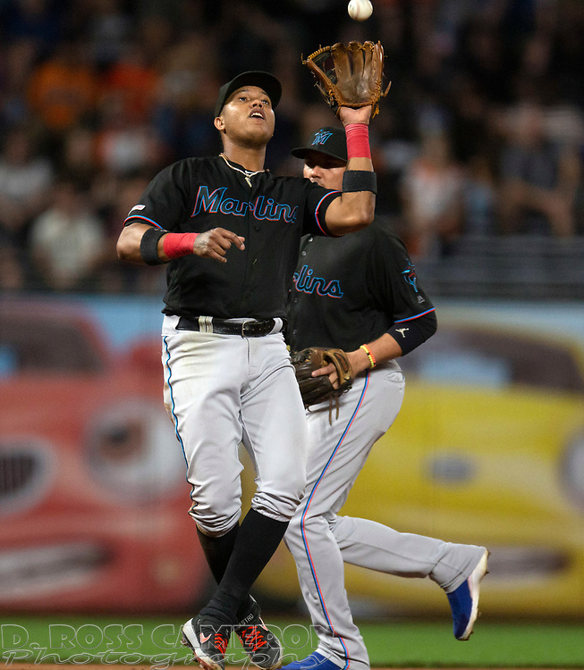 Sep 13, 2019; San Francisco, CA, USA; Miami Marlins third baseman Starlin Castro (13) makes the catch of a popup off the bat of San Francisco Giants Kevin Pillar during the second inning of a baseball game at Oracle Park. Mandatory Credit: D. Ross Cameron-USA TODAY Sports