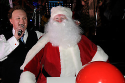 © under license to London News Pictures.  19.11.2010, Mr Tumble (Justin Flecter,MBE) from CBBC.switching the xmas lights on at the winter gardens,Bluewater,Greenhithe,.Kent. Santa popping in to say hi, but did not help switch the lights on. that was sam meads  job he is age 2..Picture credit should read Grant Falvey/London News Pictures
