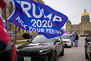"21 NOVEMBER 2020 - DES MOINES, IOWA: A Donald Trump flag on a car behind the Iowa State Capitol. About 100 supporters of US President Donald Trump gathered at the Iowa State Capitol to rally in support of the President and in opposition to the outcome of the US election. They are a part of the ""Stop the Steal"" movement which has spread across the US. This is the third week that there have been ""Stop the Steal"" rallies across the US. Most independent observers and election officials, both Republican and Democratic, have said the election was free and fair and that there was no election fraud.    PHOTO BY JACK KURTZ"