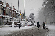 Street scene in Kings Heath during heavy snow fall on Sunday 10th December 2017 in Birmingham, United Kingdom. Deep snow arrived in much of the UK, closing roads and making driving treacherous, while many people simply enjoyed the weather.