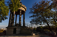 Temple of the Isle of Belvedere at Buttes-Chaumont Park is a reproduction of the Vesto temple at Tivoli Gardens in Rome, sitting atop Belevedere Island in the middle of the park. Parc des Buttes-Chaumont is one of the most romantic parks in Paris though it was once a quarry. Consequently there are many rock formations and hills that are made use of in the design of the park. Jean-Charles Adolphe Alphand's plan was to re-use the rock formations to their advantage in creating a hilly terrain, with trails leading up to a pavilion on a high cliff.  There are also waterfalls and a bridge which springs from a cliff face to a pinacle crowned by a temple. Buttes-Chaumont is considered to be a triumph in landscape design