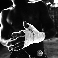 USE ARROWS ← → on your keyboard to navigate this slide-show<br /> <br /> Yangon, Myanmar May 2006<br /> Boxing fighters of the KLN boxing school. Most of them are part of the Karen minority ethnic group.<br /> On this picture: Boxer Saw Zaw Lwin , 34 years old.<br /> Photo: Ezequiel Scagnetti