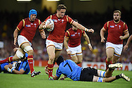 Hallam Amos of Wales makes a break.Rugby World Cup 2015 pool A match, Wales v Uruguay at the Millennium Stadium in Cardiff, South Wales  on Sunday 20th September 2015.<br /> pic by  Andrew Orchard, Andrew Orchard sports photography.