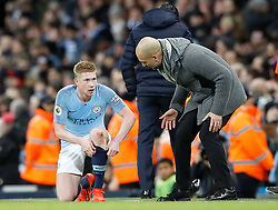 Manchester City's Kevin De Bruyne (left) has words with Manchester City manager Pep Guardiola during the Premier League match at the Etihad Stadium, Manchester.