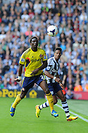 Sunderland's Modibo Diakite (l) battles for the ball with Albion's Scott Sinclair.  Barclays Premier league match, West Bromwich Albion v Sunderland at the Hawthorns in West Bromwich, England on Sat 21st Sept 2013. pic by Andrew Orchard, Andrew Orchard sports photography,